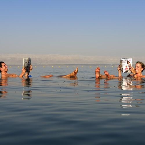 Tourists bath in Dead Sea, Jordan, Middle East, Orient- Model Released -